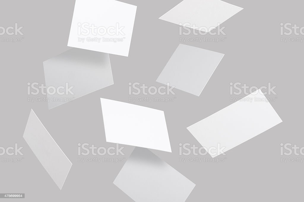 Flying business cards stock photo