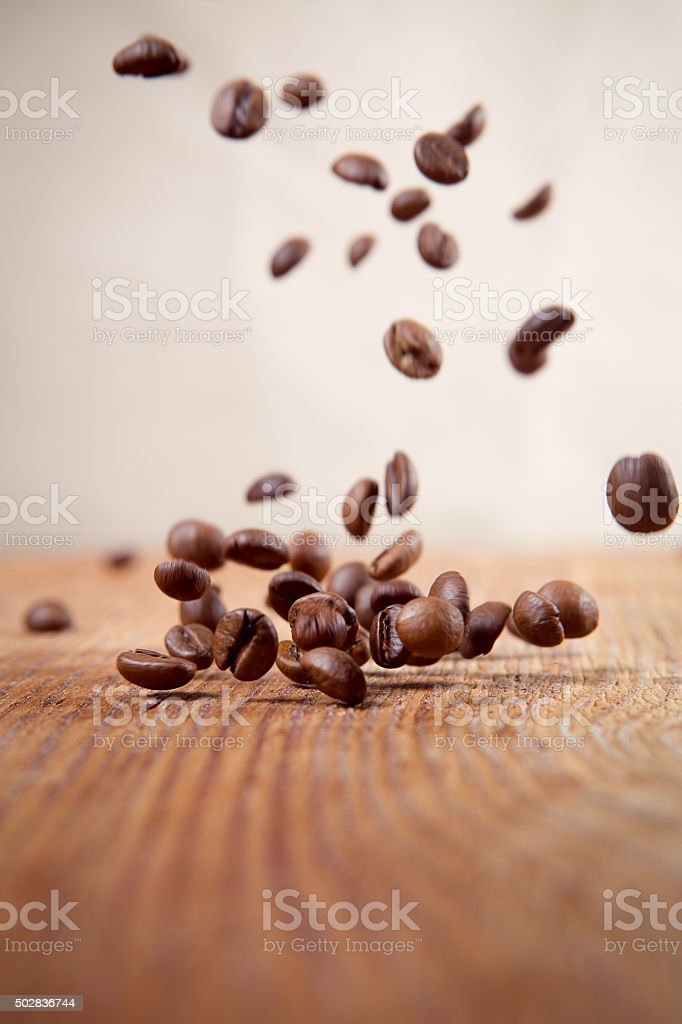 Flying coffee beans on a abstract background stock photo