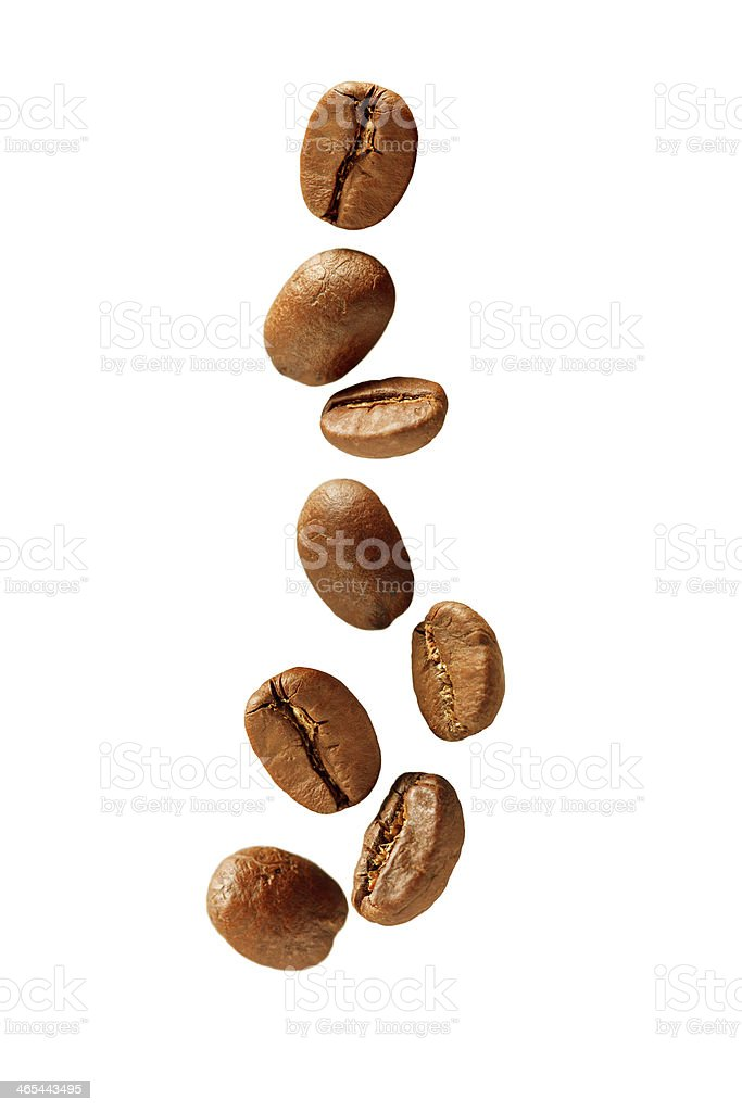 Flying coffee beans stock photo