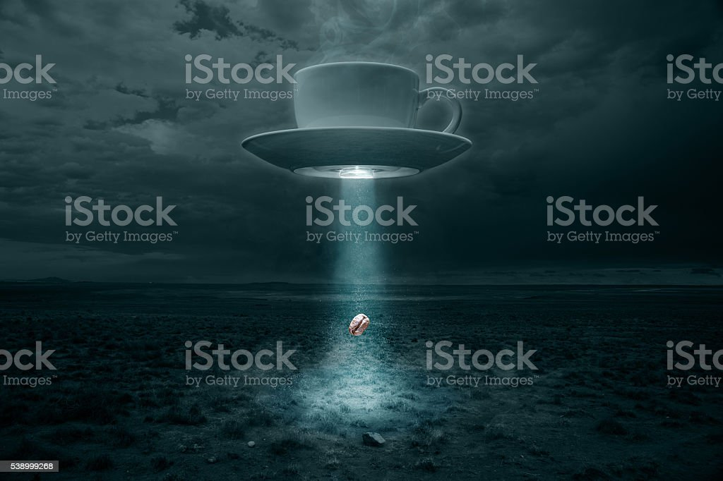 Flying Cup and Saucer Abducting a Coffee Bean stock photo
