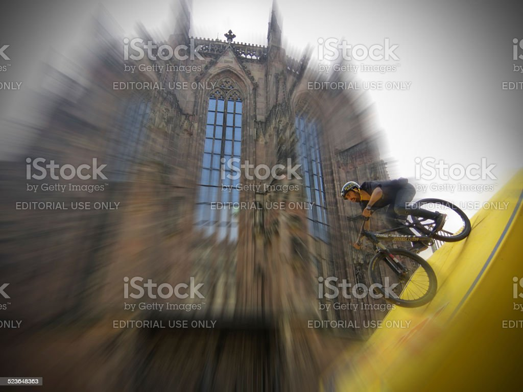 flying cyclist - 'District Ride' in Nuremberg stock photo