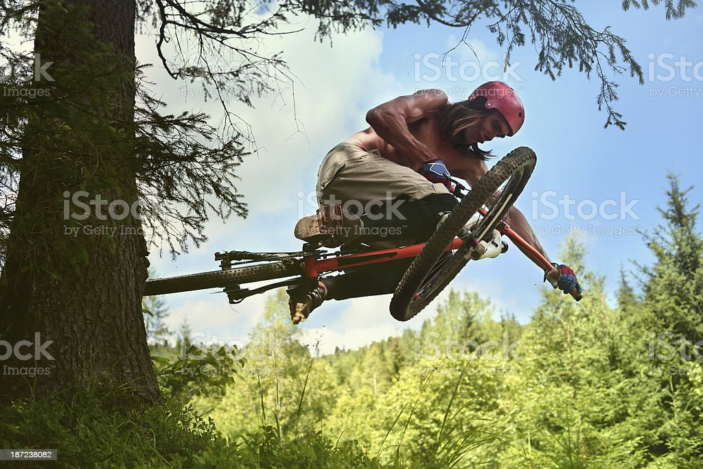 Flying cyclist stock photo