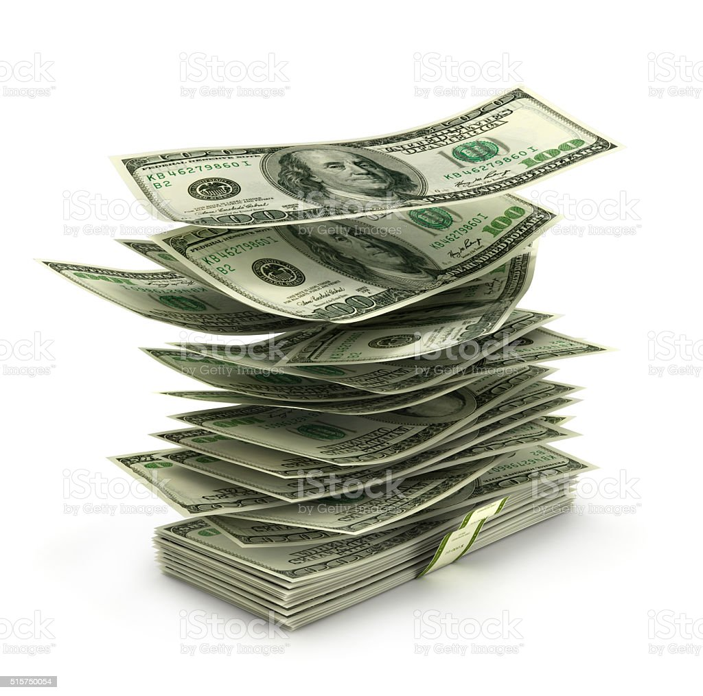 flying dollar bills in stack stock photo