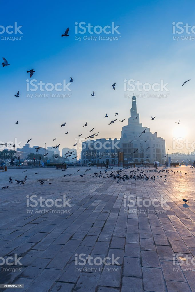Flying Doves in front of Qatar Islamic Cultural Center (FANAR) stock photo