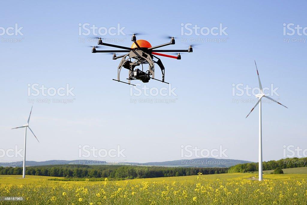 Flying drone in field stock photo