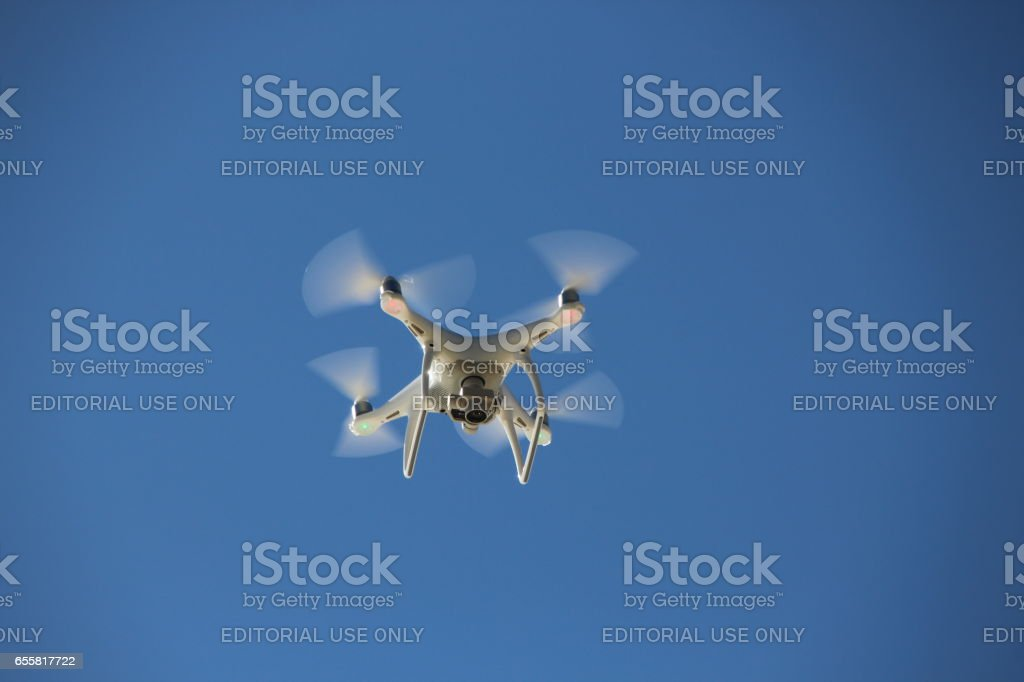 Flying Drone in the clear sky of the Seychelles stock photo