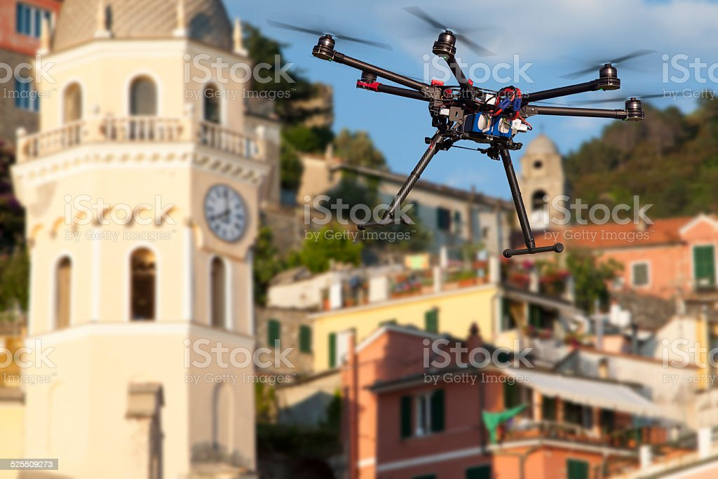 Flying drone in the skies of Vernazza stock photo
