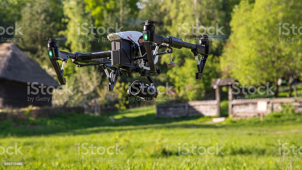 Flying drone is filming in the countryside stock photo