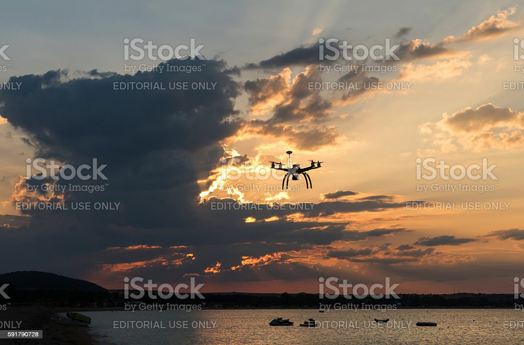 Flying drone over the sea stock photo