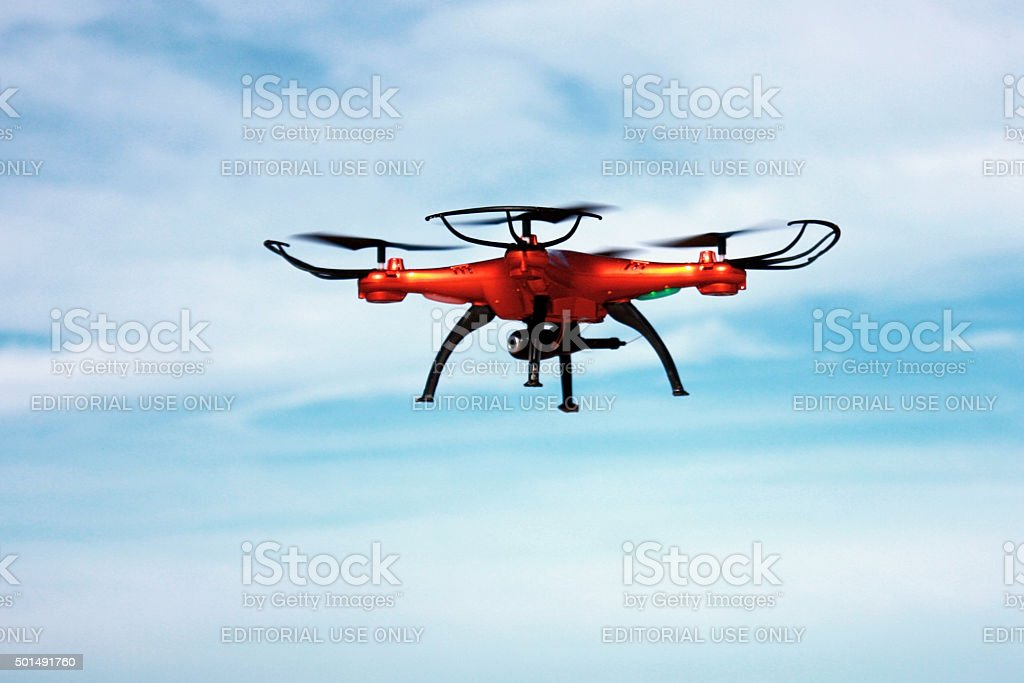 Flying drone with mounted camera in the sky stock photo