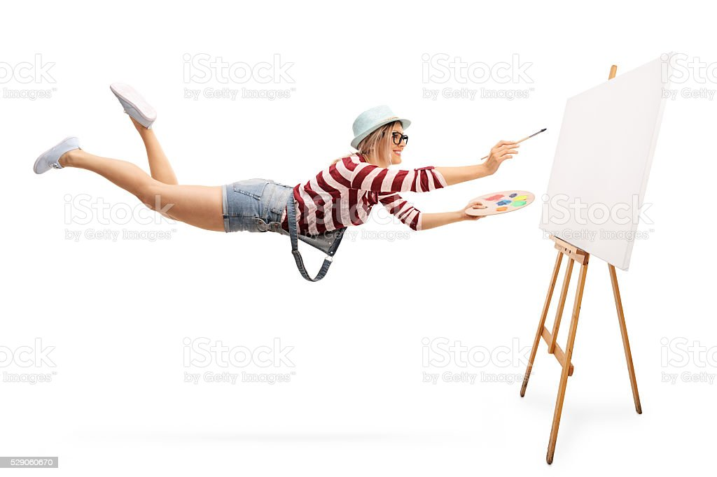 Flying female artist with a paintbrush stock photo