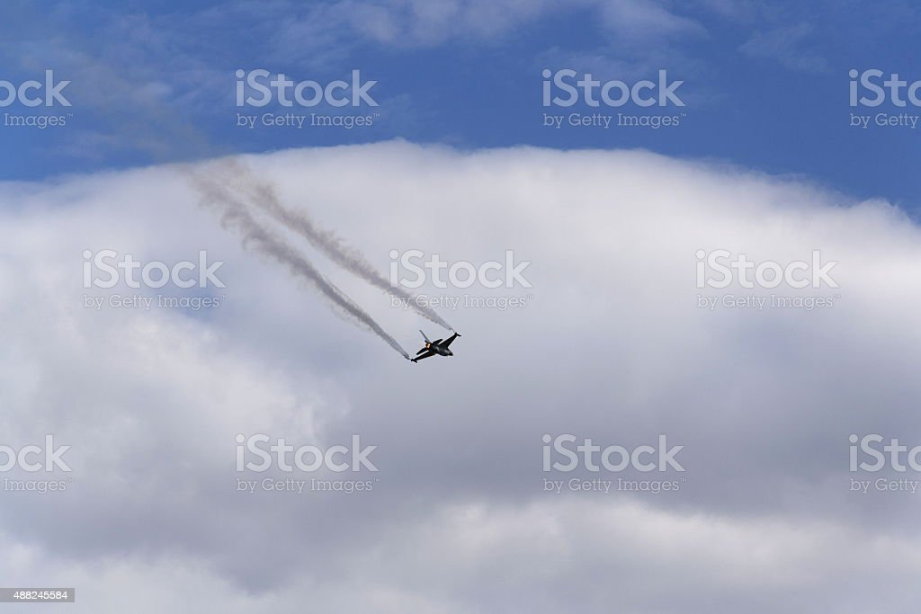 Flying fighter General Dynamics F-16 Fighting Falcon stock photo