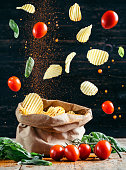Flying Food - Chips And Tomatoes