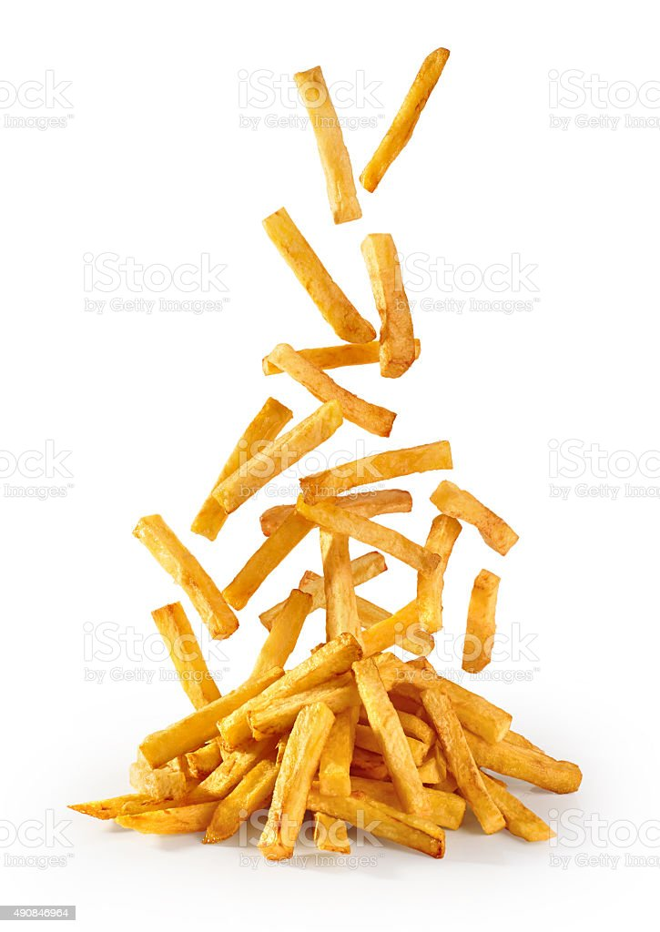 Flying fried potatoes isolated on white background. French fries stock photo