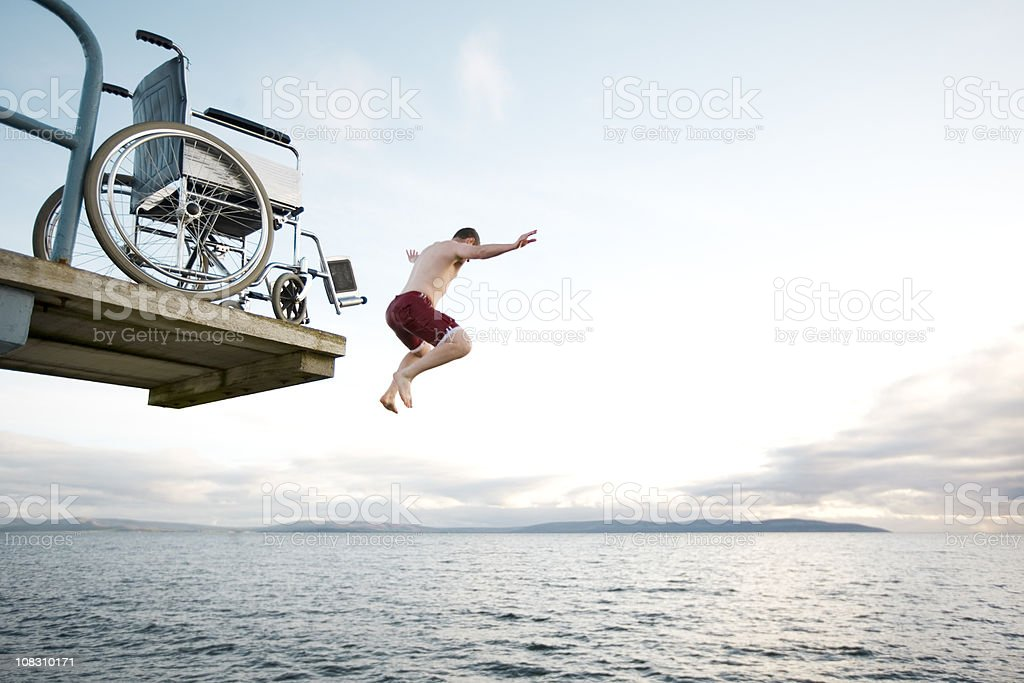 flying from wheelchair stock photo