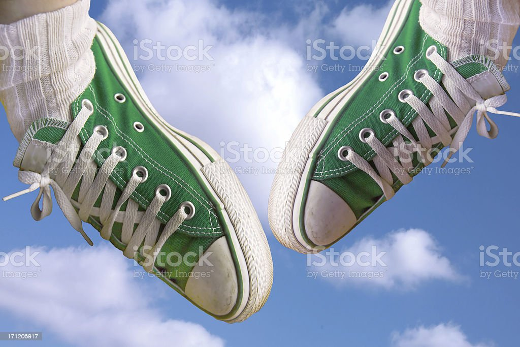 flying green sneakers royalty-free stock photo