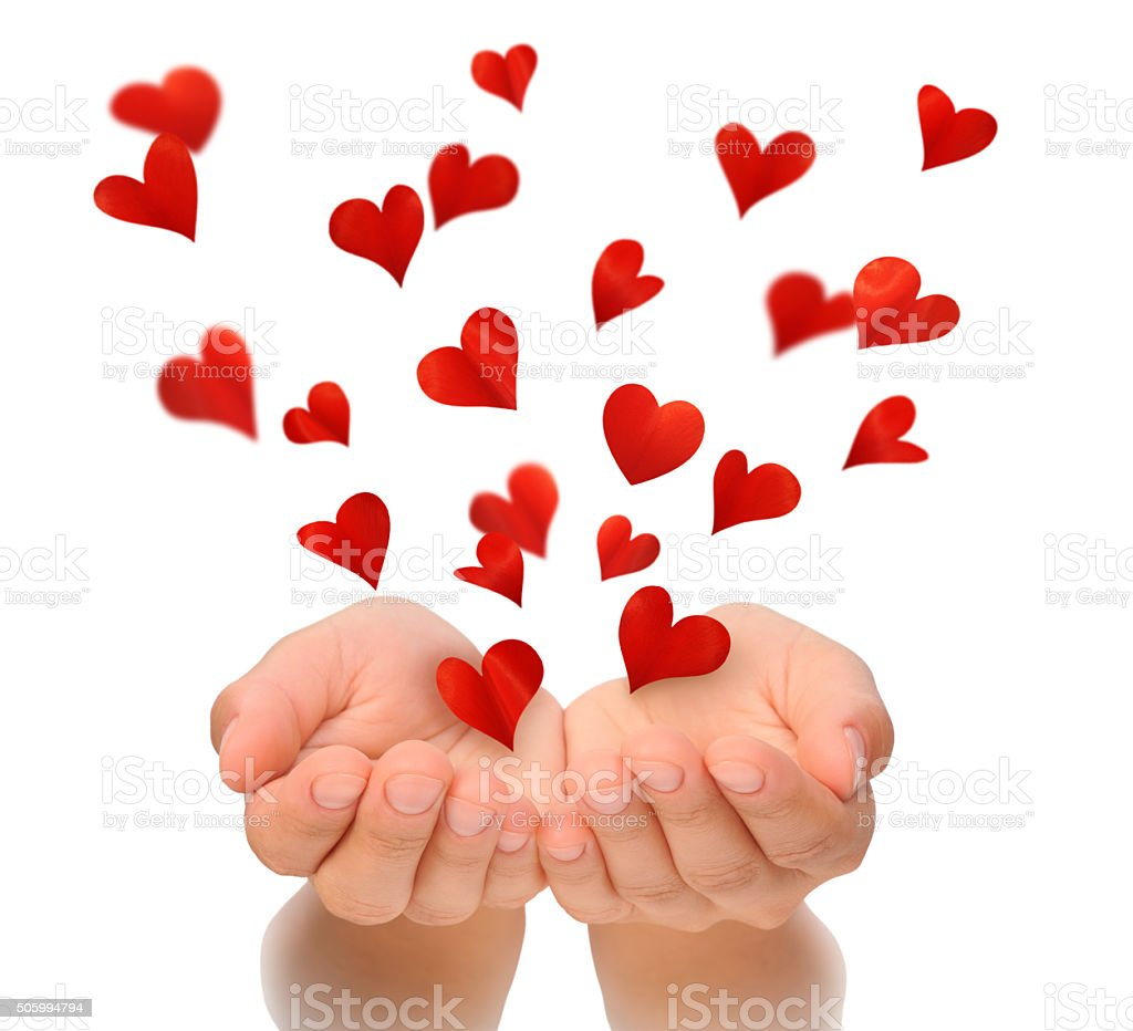 Flying hearts from hands, Valentine's Day, love concept, birthday card stock photo