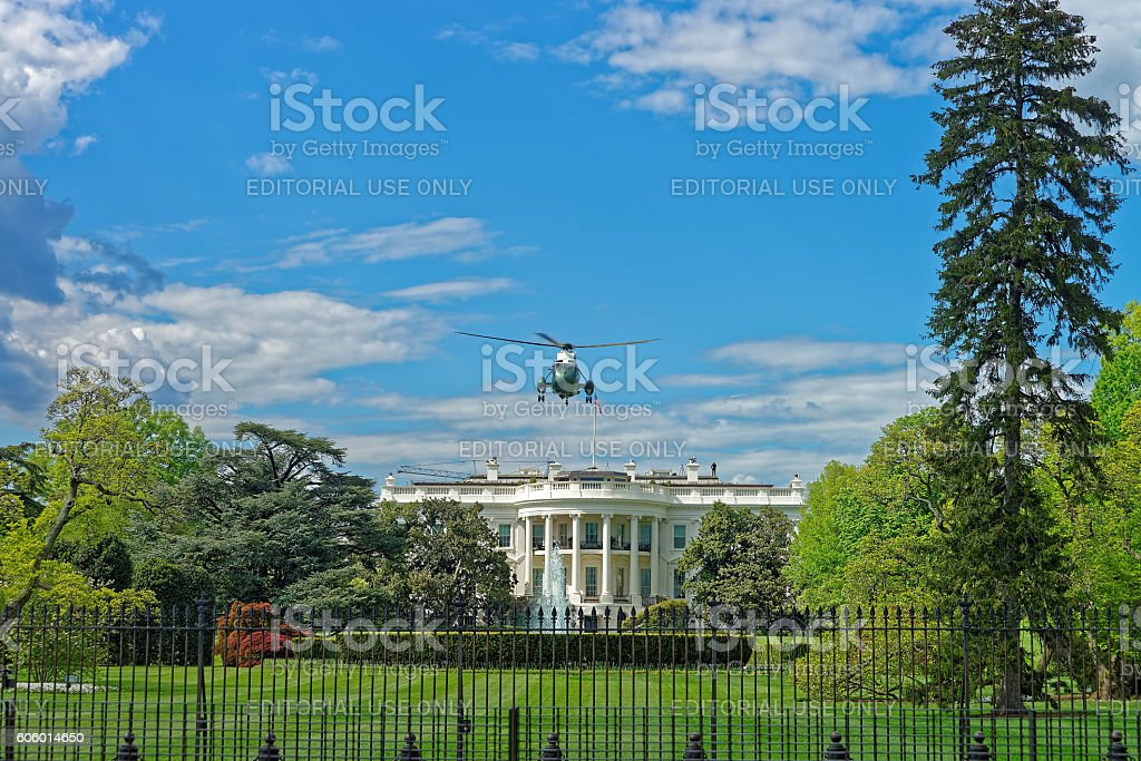 Flying helicopter above the White House stock photo