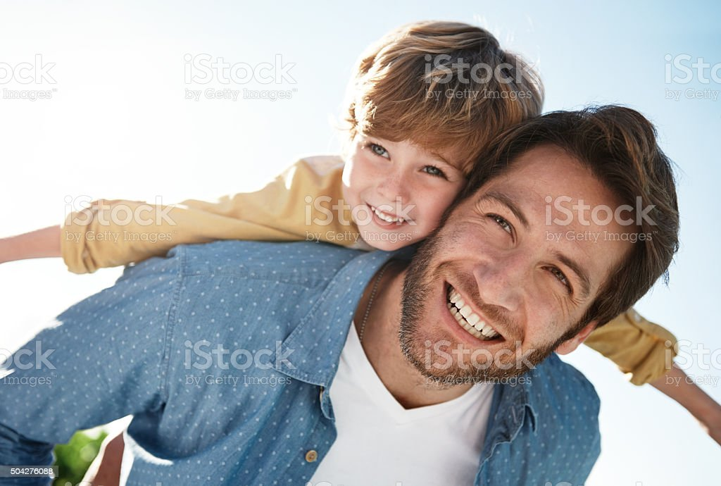 Flying high with dad stock photo