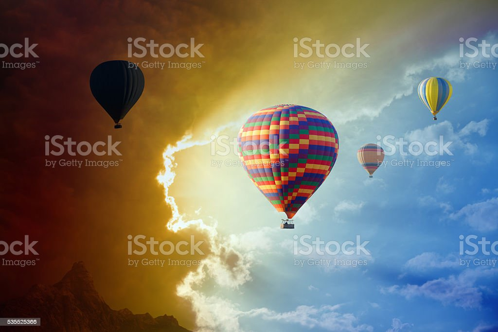 Flying hot air balloons in stormy sky stock photo