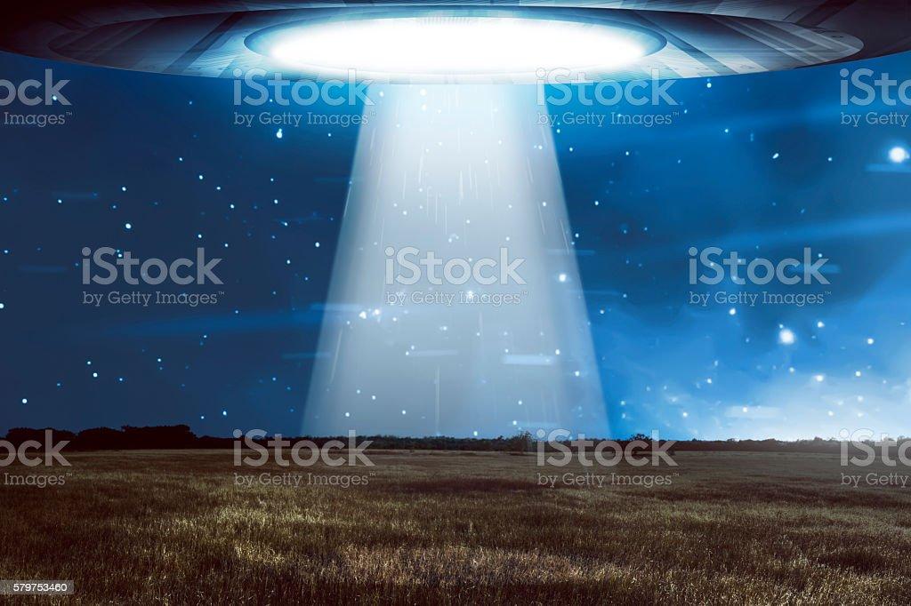 UFO flying in a dark sky stock photo