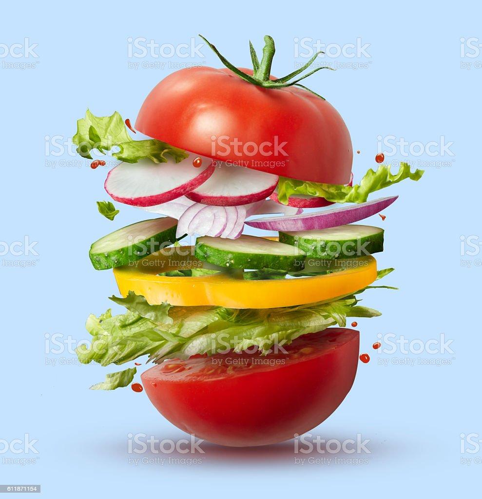 Flying ingredients of vegan burger stock photo