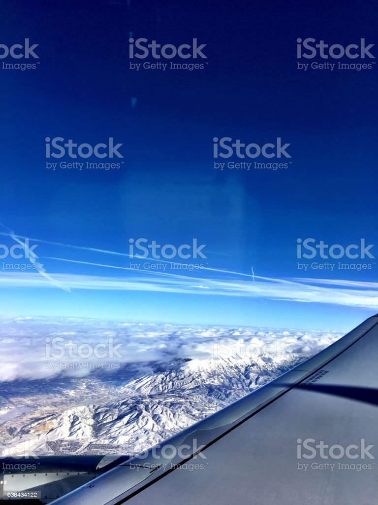 flying into the clouds stock photo