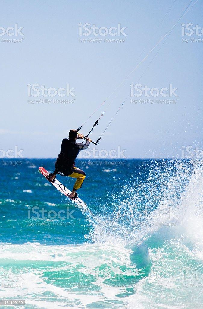 Flying kite surfer stock photo