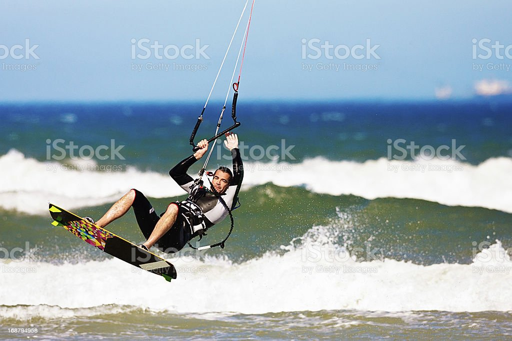 Flying kiteboarder in action jumping the waves royalty-free stock photo
