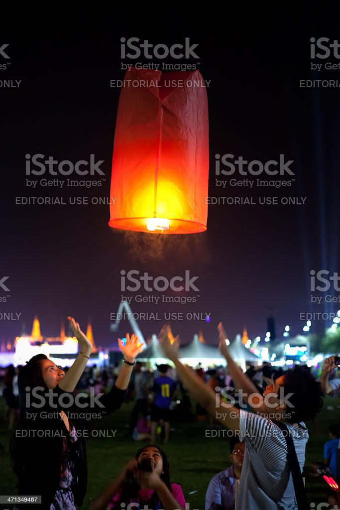 Flying lantern during Thai celebration stock photo