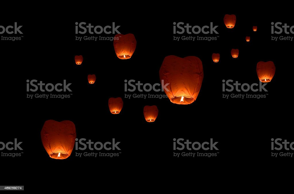 Flying lantern in the dark sky stock photo
