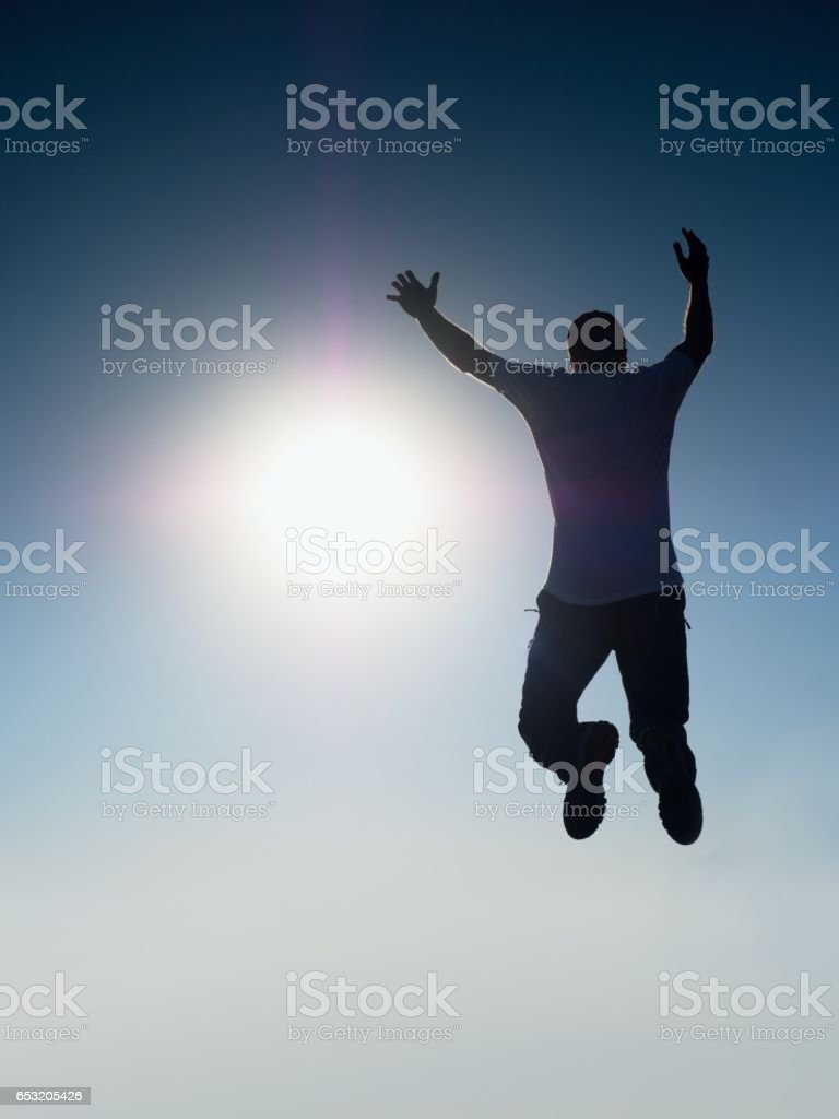 Flying man. Young man falling.  Silhouette of poise man stock photo