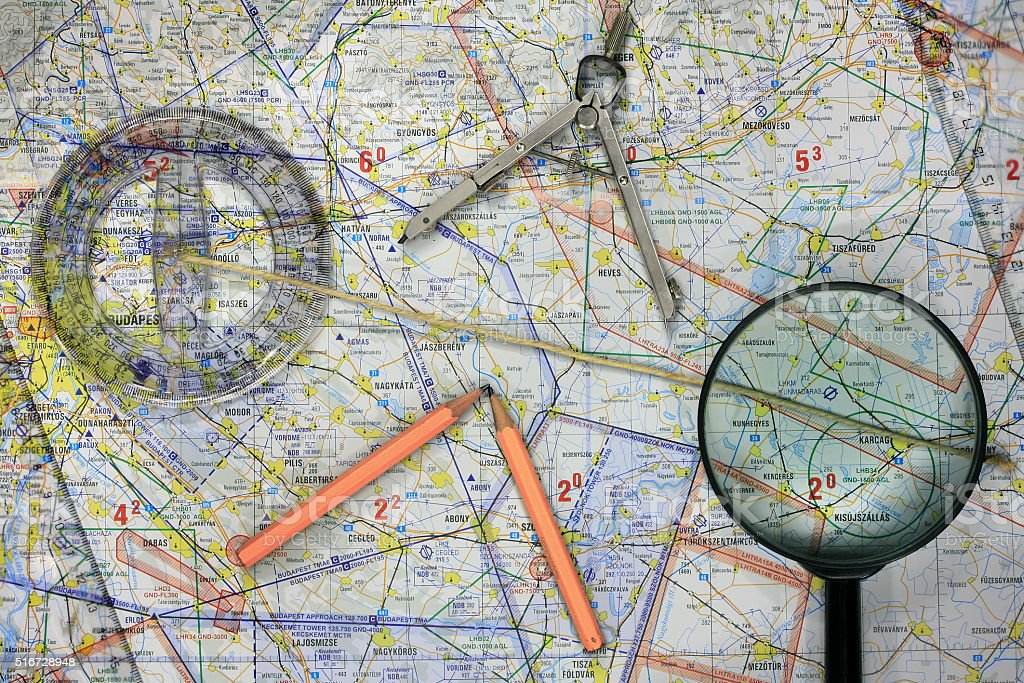 Flying map with tools stock photo