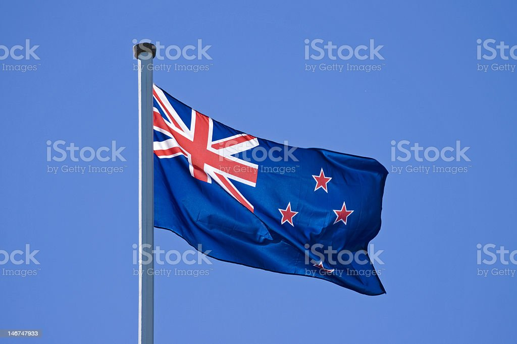 Flying New Zealand Flag royalty-free stock photo