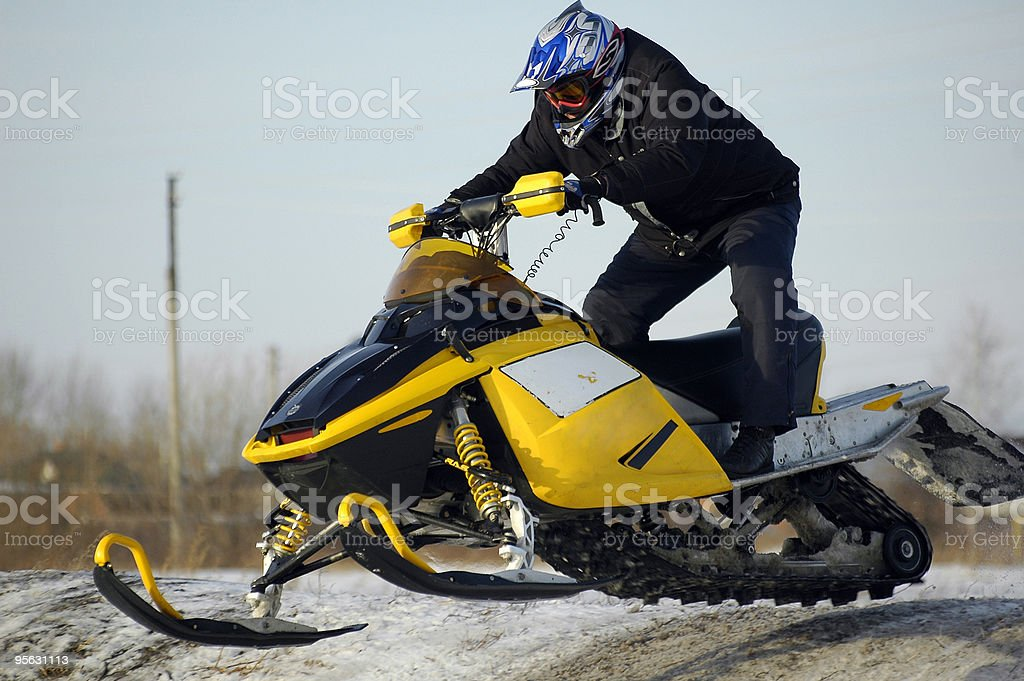 Flying of ski mobile rider royalty-free stock photo