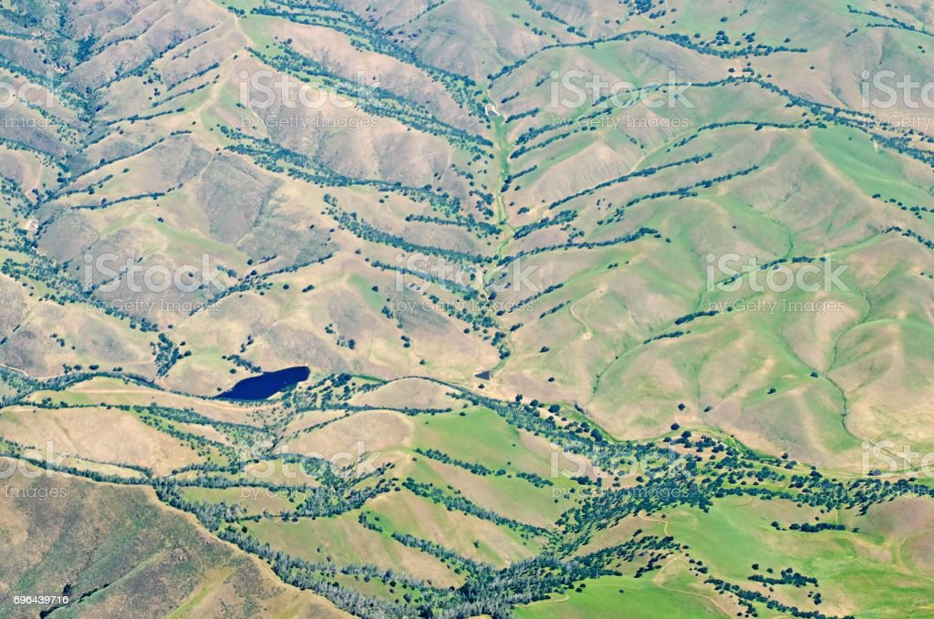 flying over california hills and valleys stock photo
