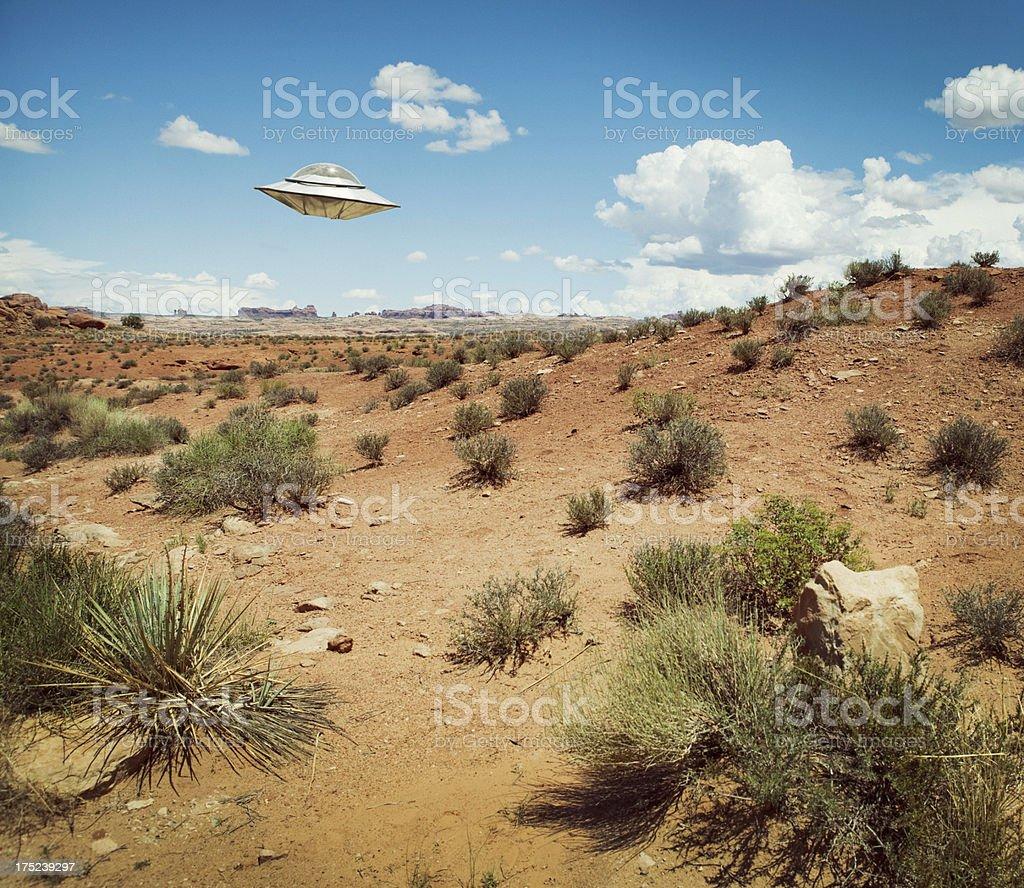 UFO Flying Over Desert stock photo