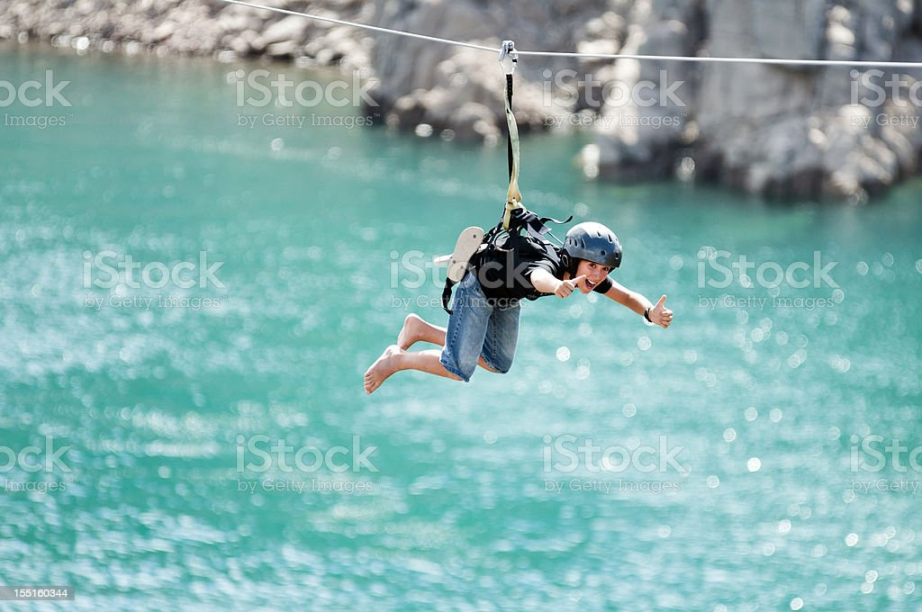 Flying over lake with tyrolean traverse stock photo