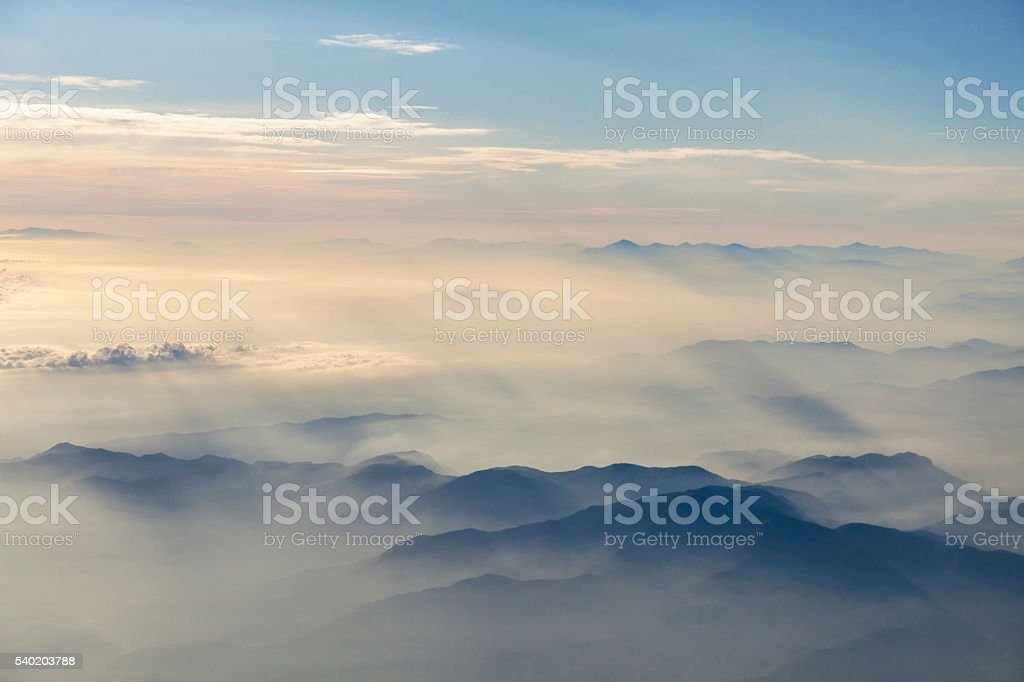 Flying over the clouds stock photo