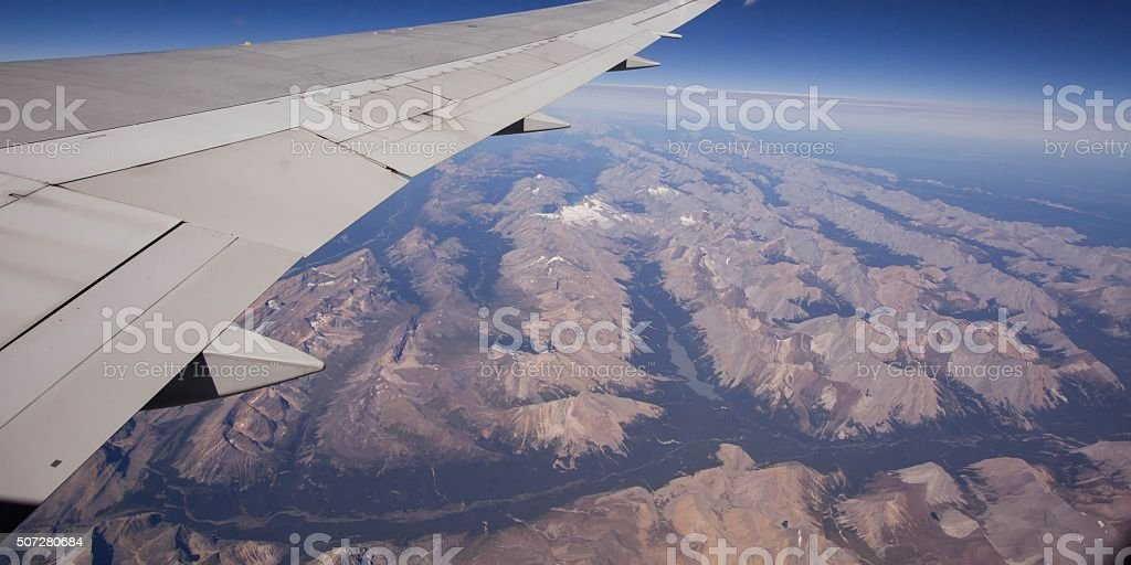 Flying over the Rockie Mountains stock photo