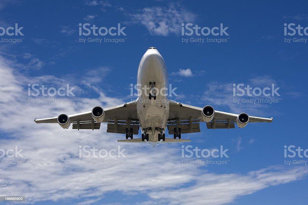 747 Flying Overhead royalty-free stock photo