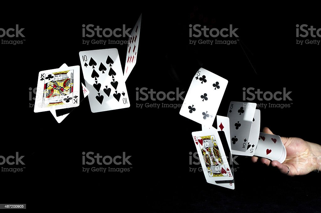 Flying playing cards stock photo