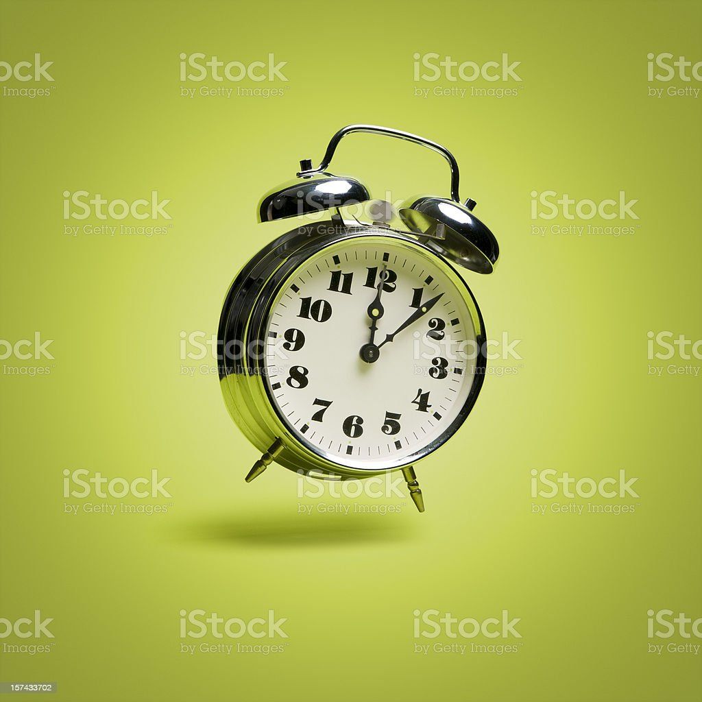 Flying retro alarm clock. Urgent Ringing Time Old green stock photo