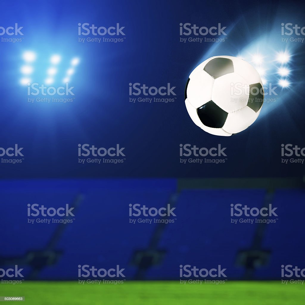 Flying soccer ball over green field, abstract sport backgrounds stock photo