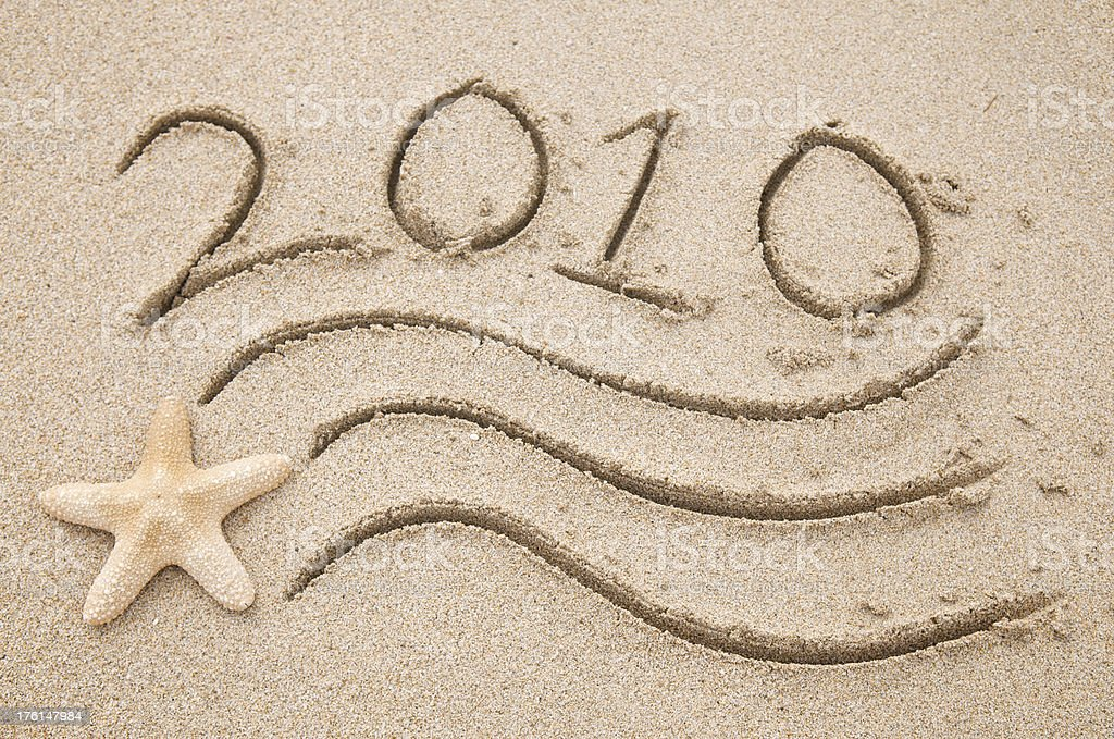 Flying Starfish 2010 Message on Beach royalty-free stock photo