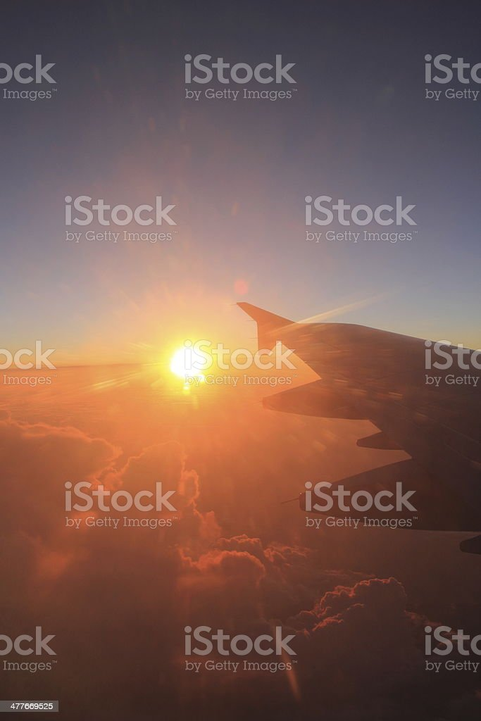 Flying - Sunbeam and an aircraft wing royalty-free stock photo
