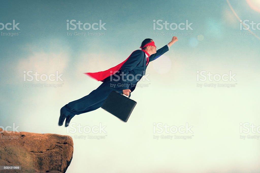 flying superhero businessman stock photo