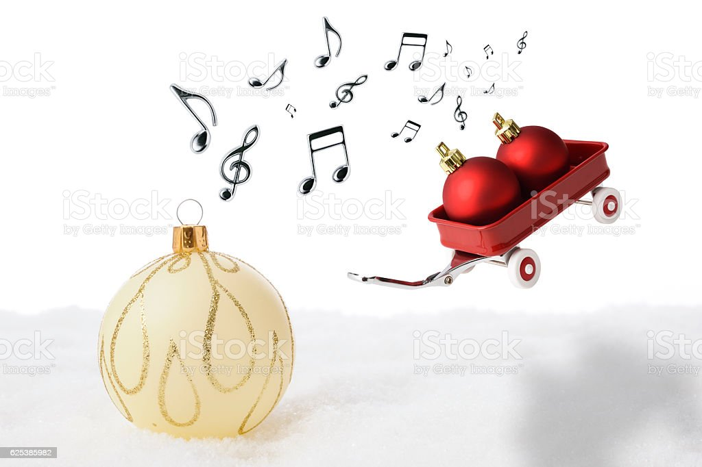 Flying toy red wagon and musical note with Christmas balls stock photo