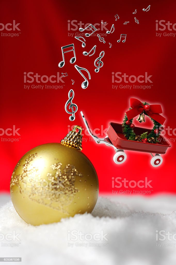 Flying toy red wagon and musical note with Christmas wreath stock photo