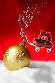 Flying toy red wagon and musical note with Christmas wreath